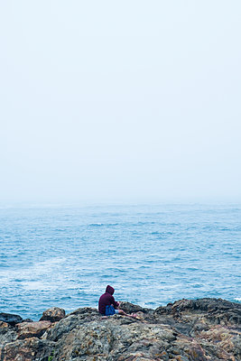Man on the seashore of Porto - p1423m2014738 by JUAN MOYANO
