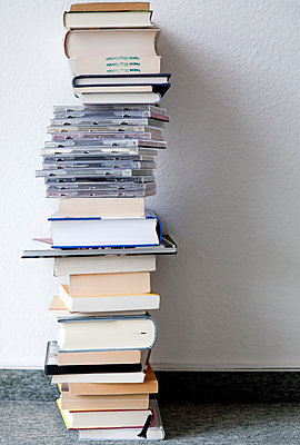 Stacked books and CD's - p580m1552862 by Eva Z. Genthe