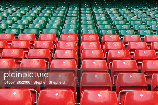 Seats in red and green - p1057m852986 by Stephen Shepherd