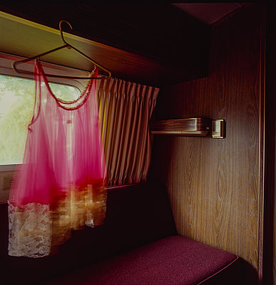Pink underwear on clothes hanger in a caravan - p1082m2228227 by Daniel Allan