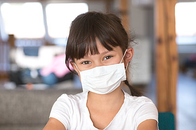 Girl wearing mask at home - p300m2180481 by Stefan Rupp