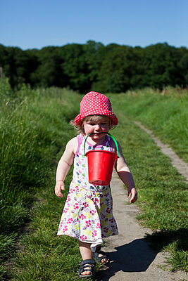 Girl with bucket - p505m912798 by Iris Wolf