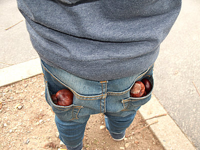 Trouser pockets filled with chestnuts - p1499m2013709 by Marion Barat