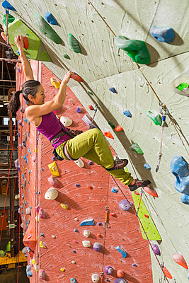 Japanese woman climbing rock wall - p555m1312132 by Don Mason