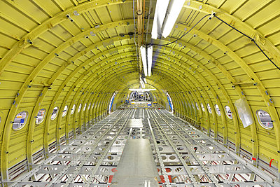 Interior of an unfinished airplane in a hangar - p300m1018809f by lyzs