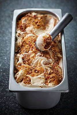 Dish of salted caramel ice cream - p42918714 by Danielle Wood