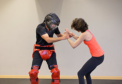 Woman training for self defense - p445m1503883 by Marie Docher