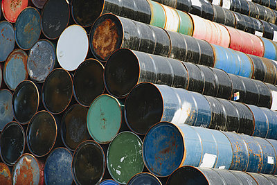 Oil barrels stacked up - p1100m876581f by Paul Edmondson