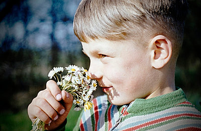 Boy with flowers - p1710303 by Rolau