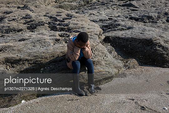 Boy Hiding his Face - p1307m2271325 by Agnès Deschamps