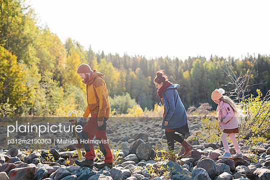 Family walking together - p312m2190363 by Matilda Holmqvist