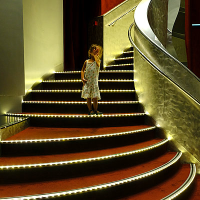 Cruise ship, Little girl on stairs - p1105m2125658 by Virginie Plauchut