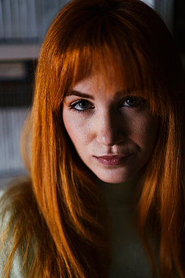 Serious redhead woman at library - p300m2256133 by DREAMSTOCK1982