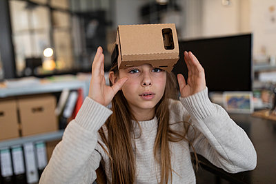 Girl with cardboard VR glasses in office - p300m2154926 by Gustafsson