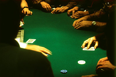group of people gambling at a casino blackjack table - p3010559f by fStop