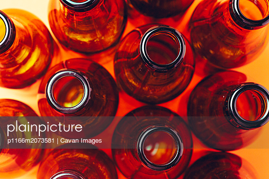 empty and brown glass bottles - p1166m2073581 by Cavan Images