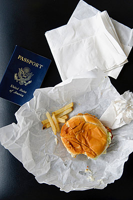 US passport with hamburger and fries - p924m700213 by Matt Dutile