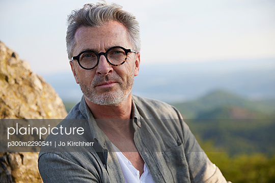 Handsome mature man with eyeglasses staring - p300m2290541 by Jo Kirchherr