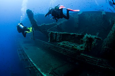 Underwater rear view of divers investigating MS Zenobia shipwreck, Larnaca, Cyprus - p429m1102964f by PhotoStock-Israel