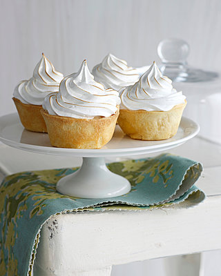 Banana meringue tarts on cake stand - p429m929395f by BRETT STEVENS