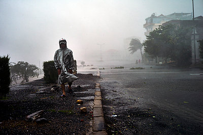 Heavy rains and severe surf along the central coastal provinces of Vietnam from the category 1 tropical storm, Typhoon Wutip, Southeast Asia - p934m1022241 by Morgan Ommer