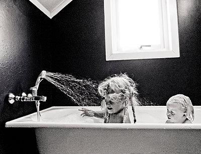 Children in the tub - p816m1032336 by Krogh, Tarjei E