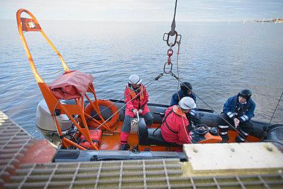 Rescue boat training by ship - p429m768917f by Monty Rakusen