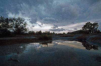 Rain pool and storm clouds, Toroweap area of Grand Canyon, Arizona, USA - p44210207f by Design Pics