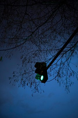 Green traffic lights at night - p445m2053325 by Marie Docher