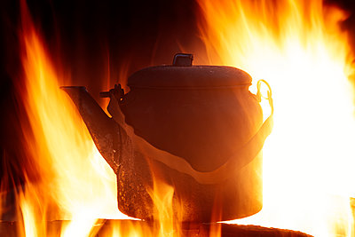 Tea kettle in the campfire - p1168m2026617 by Thomas Günther