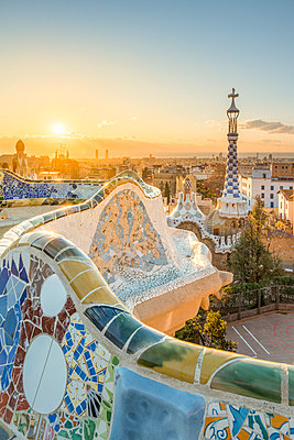 Barcelona, Catalonia, Spain, Southern Europe. Unique Antoni Gaudi's architecture of Park Guell at sunrise. - p651m2006886 by Marco Bottigelli