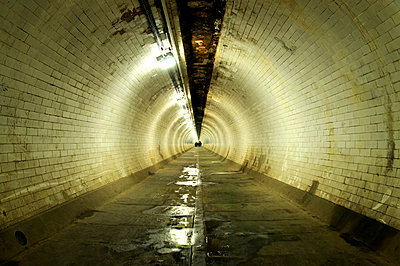 Empty damp foot tunnel - p1072m829321 by Neville Mountford-Hoare