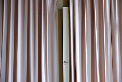 Pink coloured curtain - p1164m1584811 by Uwe Schinkel