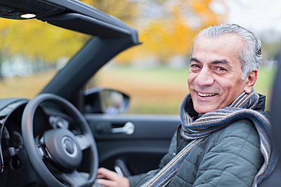 Portrait smiling, confident senior man in convertible - p1023m1575881 by Tom Merton