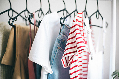 Rack filled with clothing. - p1166m2078185 by Cavan Images