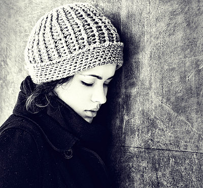 Sad young woman with knit hat - p1445m1574932 by Eugenia Kyriakopoulou