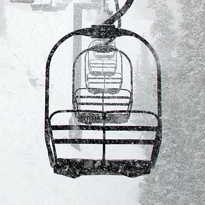 Chairlift in a Blizzard - p343m1218117 by Jon Paciaroni