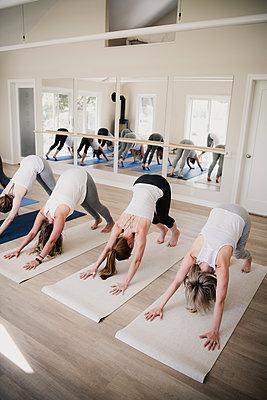 Women at yoga retreat - p429m2019522 by Hugh Whitaker