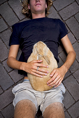 Rabbit lying on boy - p1125m2013970 by jonlove