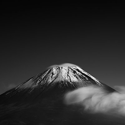 View of Mount Fuji with clouds, Yamanashi Prefecture, Japan - p1166m2078146 by Cavan Images