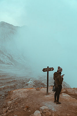 Woman with cell phone at Ijen volcano, Java, Indonesia - p300m2140865 by Konstantin Trubavin