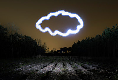 Field landscape at night with light painted drawing of cloud - p429m929025f by Mischa Keijser
