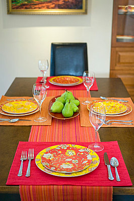 Detail colorful place settings on dining room table - p5551902f by Auda & Coudayre Photography