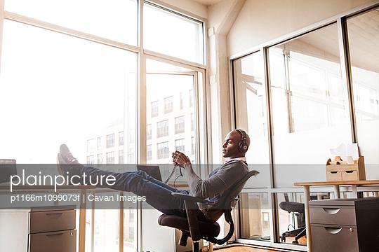 Man relaxing in office