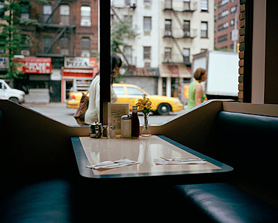 An empty booth in a diner - p3017018f by Emily Keegin