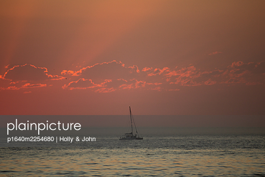 Sailing boat at sunset - p1640m2254680 by Holly & John