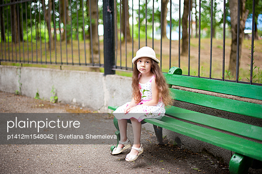 Portrait of a little girl in the park - p1412m1548042 by Svetlana Shemeleva