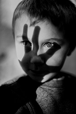 Boy With Hand Shadow Face - p1169m956020 by Tytia Habing
