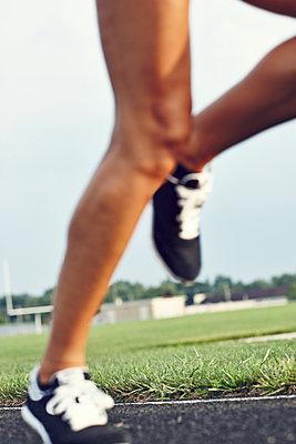 Runner on stadium - p312m1121461f by Johan Alp