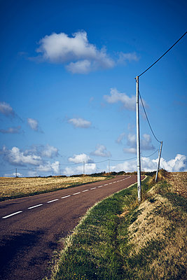 Rural road with blue sky and clouds - p1312m2279016 by Axel Killian